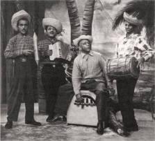 """EL TRIO REYNOSO ( En la imagen Cuatro integrantes ) El Mas Famoso Conjunto Tipico durante """" La Era de Trujillo """" ( 1930/1961 ). Pedro Reynoso , Acordeonista ; su hermano Domingo , con la Guira ; Pancholo Esquea , con la tambora ;y Chirichito con la marimba. Imagen de la decada del 50. Fuente: AGN El Trío Reynoso, conocidos como """"Los Reyes del Merengue Típico"""" es considerado como uno de los mejores grupos musicales de merengue típico. Los miembros del Trío Reynoso fueron el acordeonista y vocalista Pedro Reynoso, El percusionista Francisco Esquea (mejor conocido como Pancholo), el güirero y vocalista Domingo Reynoso, y el marimbero y güirero Milcíades Hernandez, conocido como uno de los mejores guireros de todos los tiempos.[ Fueron considerados como el grupo latino más popular durante y después de la era de Trujillo.[ Alcanzaron la fama en lugares más allá de las fronteras dominicanas tales como en Cuba, Puerto Rico y otras partes de Latinoamérica. Las canciones más populares de su repertorio fueron: """"Juanita Morel"""", """"Alevántate"""", """"Chanflin"""", """"El Pichoncito"""", """"María Luisa"""", """"El Picotiao"""" y """"La Lisa""""."""